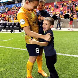 Utah Royals FC forward Amy Rodriguez (8) hugs her two sons Ryan and Luke after a match against the Orlando Pride at Rio Tinto Stadium in Sandy on Wednesday, May 9, 2018.