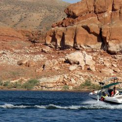 A boater on Lake Powell enjoys scenery in Halls Creek Bay, August 10, 2009.