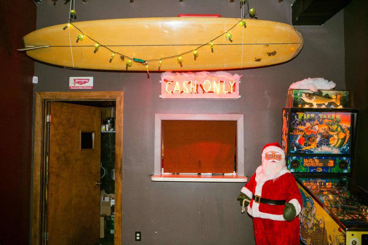 Santa and his surfboard at Nickel City