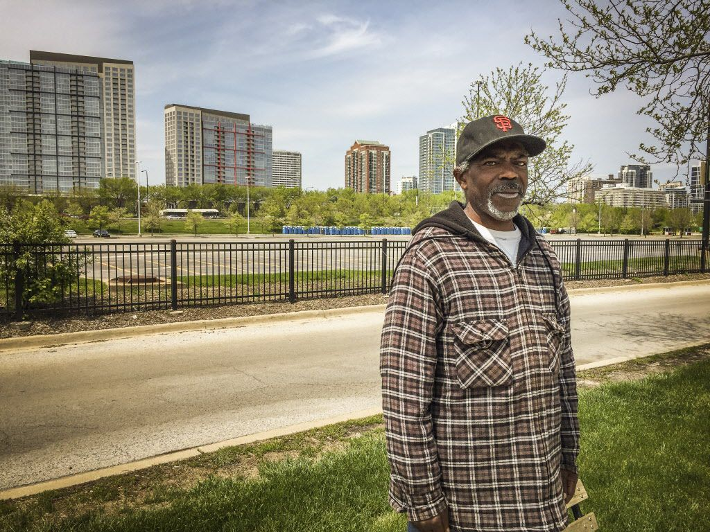 Vincent Smith, 61, pauses from his walk along the Lakefront Trail at the parking lot originally proposed as the site for the Lucas Museum of Narrative Art. | Mark Brown/Sun-Times