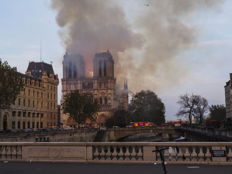 "A huge column of smoke stands above the Notre-Dame Cathedral in Paris as what the mayor of the French capital described as a ""terrible fire."""