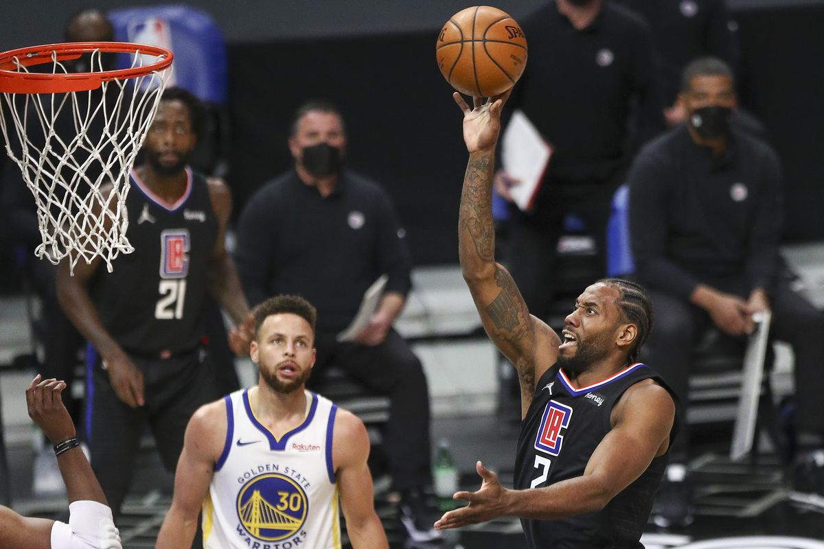 Kawhi Leonard of the LA Clippers shoots the ball in the first half against the Golden State Warriors at Staples Center on March 11, 2021 in Los Angeles, California.