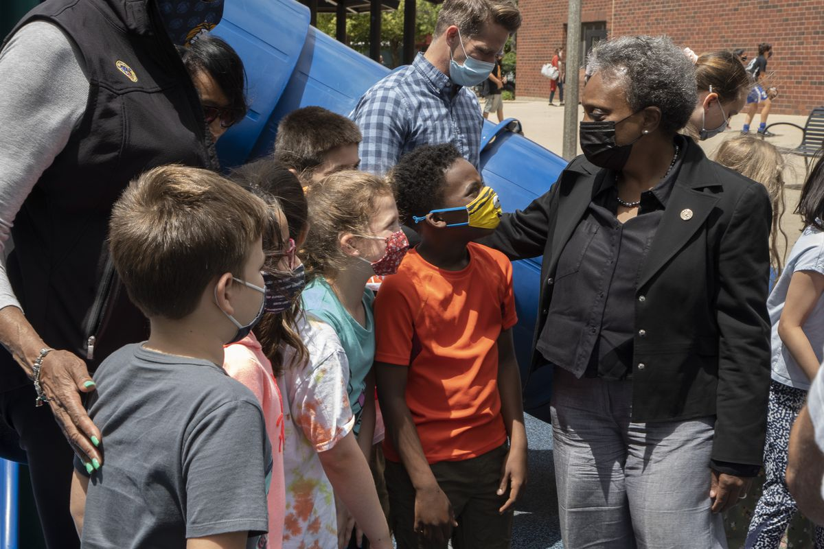 Mayor Lori Lightfoot talks with students on her visit to South Loop Elementary School on Tuesday, June 22, 2021.