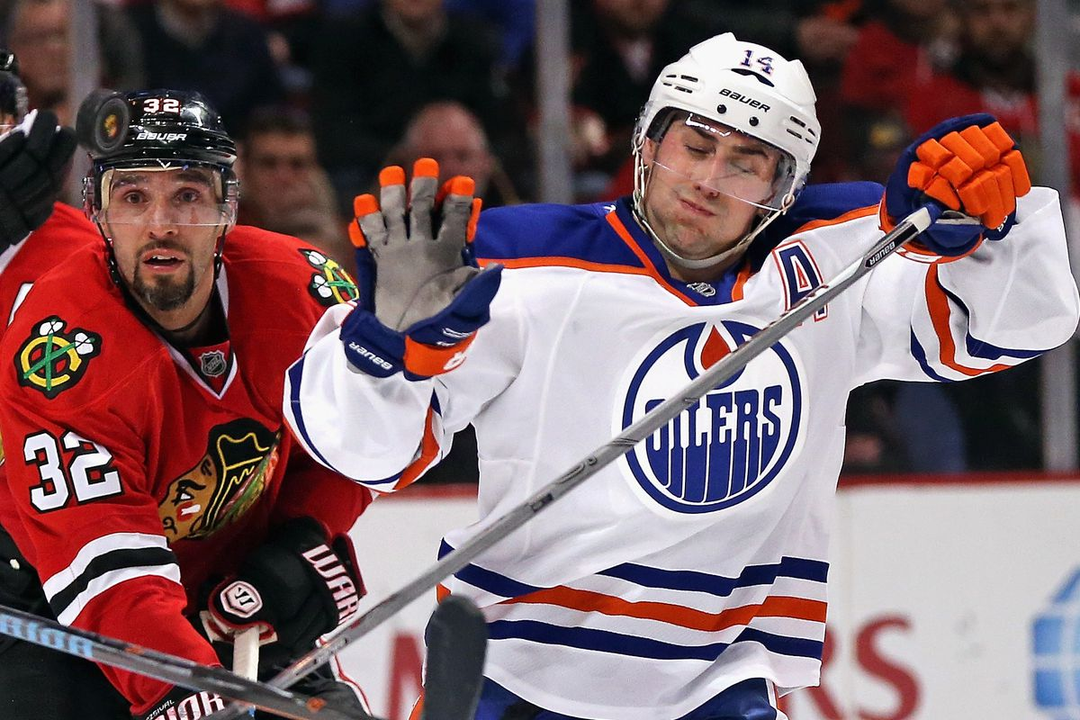 """Above: Michal Roszival (left) wonders why his team are a bunch of muffins while Jordan Eberle (right) is all, like, """"I got this""""."""