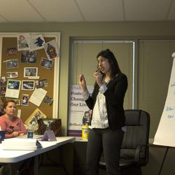 Utah Foster Care trainer Liz Rivera teaches one of the eight, four-hour classes required to train and educate potential foster parents on Wednesday, Jan. 10, 2016, at the Utah Foster Care Foundation in Murray.