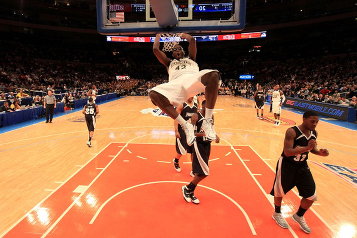 In hopes of not killing himself, Chris Otule hangs on the rim. Ref does not care about Otule's life. Calls technical foul. Big East refs suck. (Photo by Chris Trotman/Getty Images)