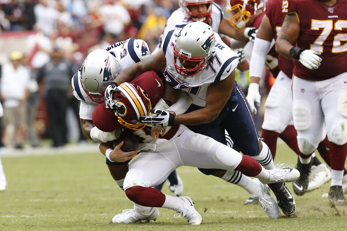 Washington quarterback Colt McCoy is sacked by New England Patriots outside linebacker Dont'a Hightower and Patriots defensive end Michael Bennett in the third quarter at FedExField.