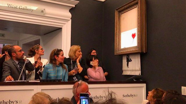 A Banksy artwork self-destructed moments after being sold at auction for 1.04 million pounds ($1.4 million), in a prank orchestrated by the elusive street artist. | Banksy Instagram via AP