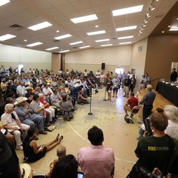 Hundreds fill a small hall in Bluff for a meeting with Interior Secretary Sally Jewell, talking about a proposed Bears Ears national monument in southern Utah on Saturday, July 16, 2016.