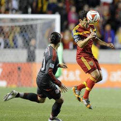 Real Salt Lake defender Tony Beltran (2) heads the ball as Toronto FC midfielder Issey Nakajima-Farran (20) watches during a game at Rio Tinto Stadium in Sandy on Saturday, March 29, 2014.