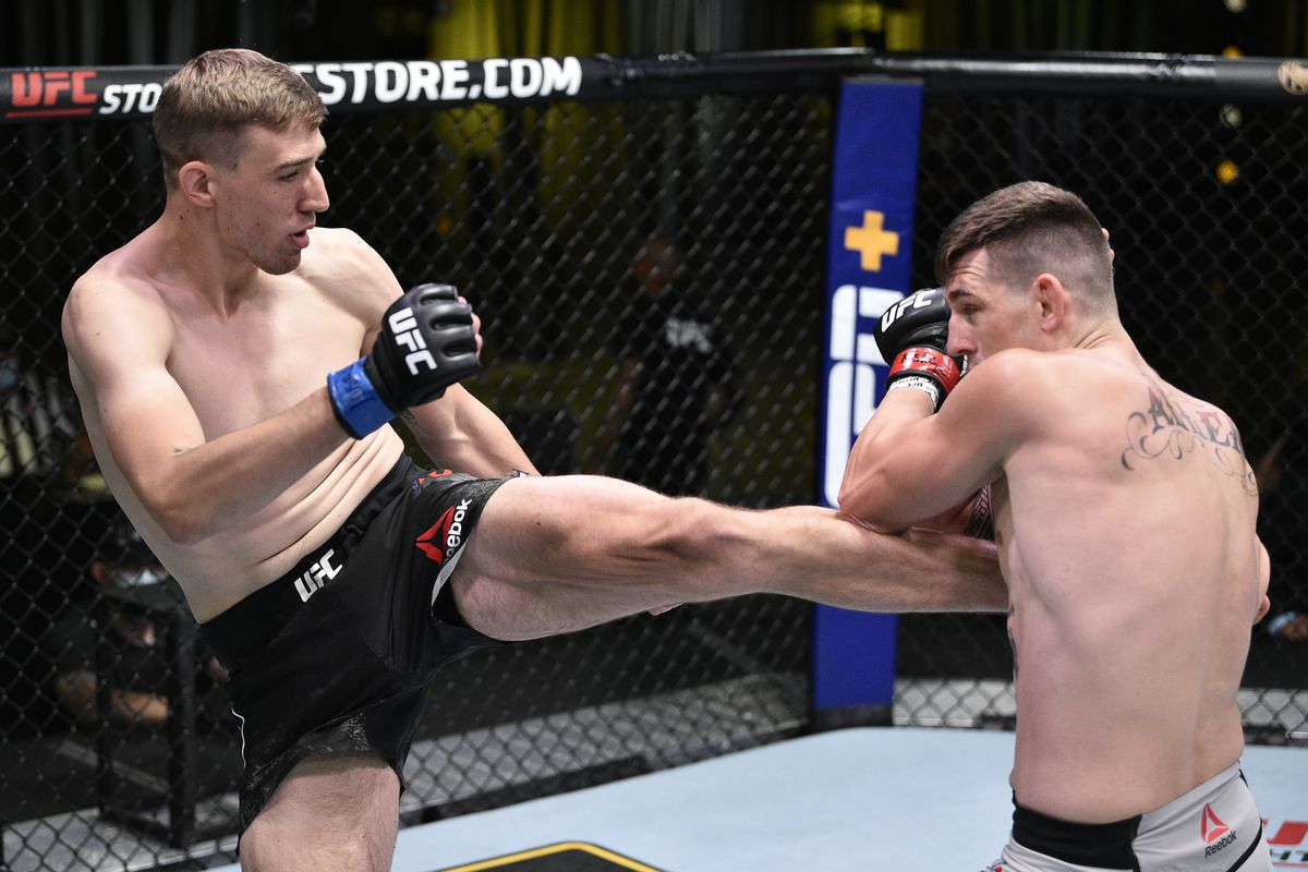 Kyle Daukaus kicks Brendan Allen in their middleweight fight during the UFC Fight Night event at UFC APEX on June 27, 2020 in Las Vegas, Nevada.