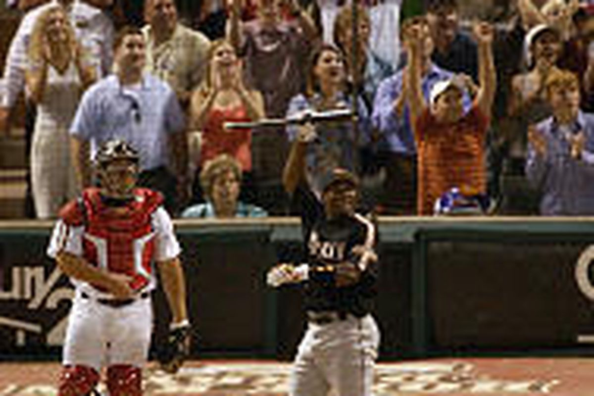 Baltimore Orioles' Miguel Tejada watches his 15th home run in the second round of the All-Star Home Run Derby Monday night.