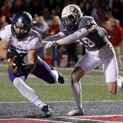 Weber State Wildcats tight end Andrew Vollert pulls in a touchdown pass with Southern Utah Thunderbirds safety Alex Sims defending during NCAA football in Cedar City on Saturday, Dec. 2, 2017.