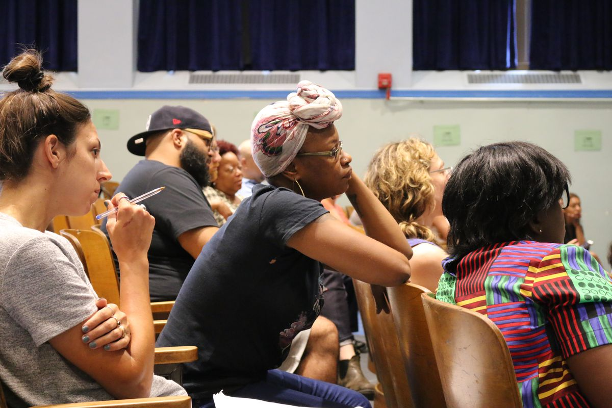 Tevina Willis, lead community organizer for the nonprofit Red Hook Initiative, listened to officials explain rezoning plans for District 15 at a meeting that was held at P.S. 676.