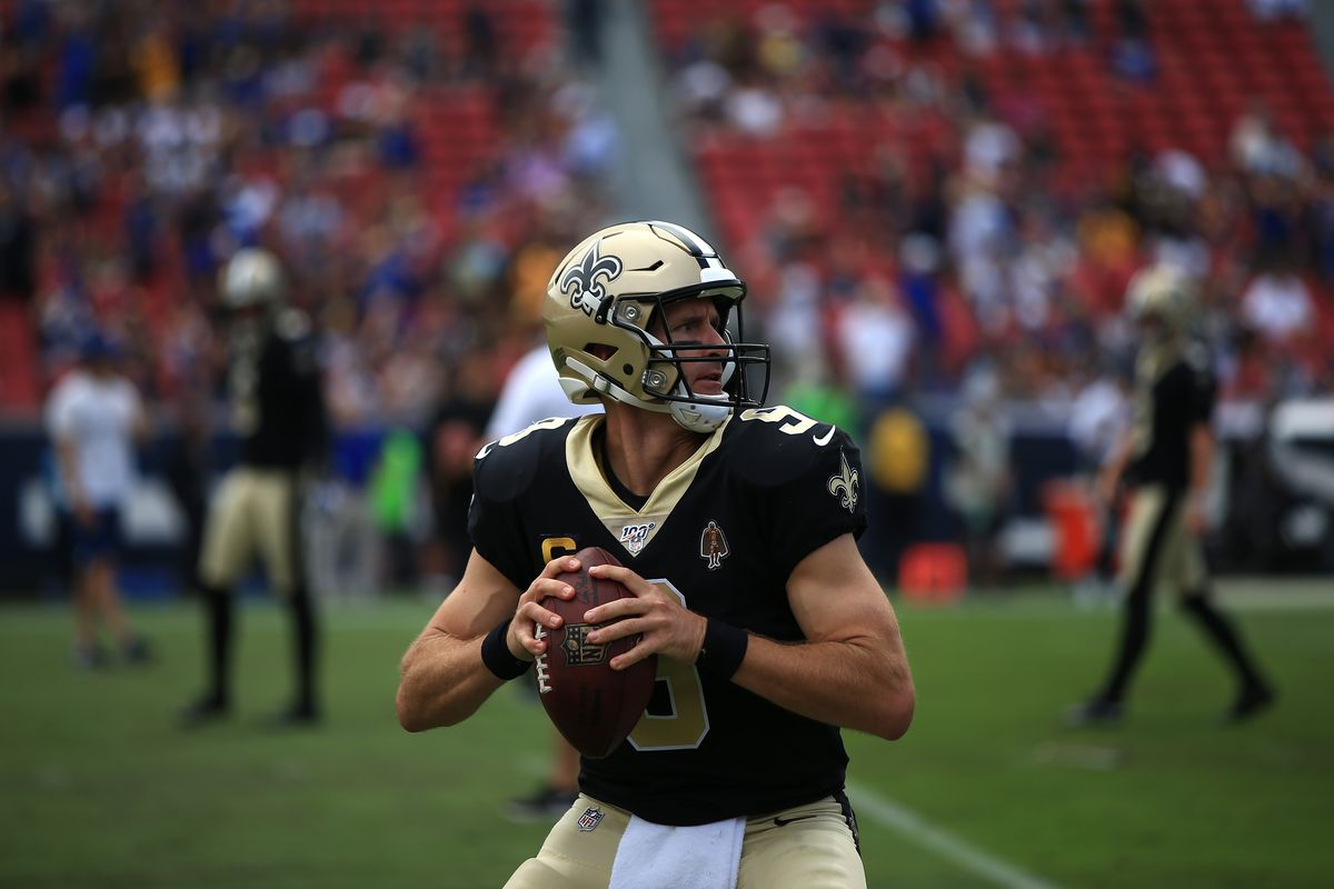 Quarterback Drew Brees of the New Orleans Saints warms up ahead of the game against the Los Angeles Rams at Los Angeles Memorial Coliseum on September 15, 2019 in Los Angeles, California.