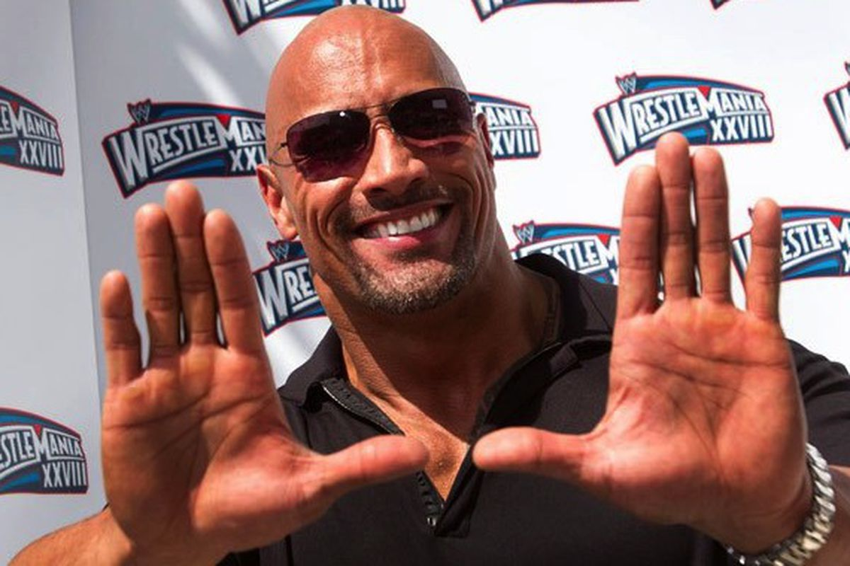 """Dwayne """"The Rock"""" Johnson  throws up the U at a wrestling event"""