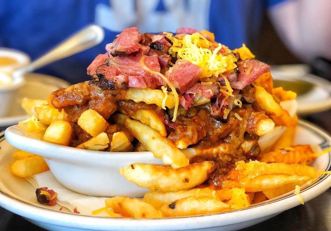 French fries topped with cheese and pastrami.
