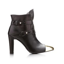 This product image released by Stuart Weitzman shows a gold metallic cap-toe black multi-strap ankle boot co-designed by actress-model Brooklyn Decker for a special Stuart Weitzman collection to help raise money for ovarian cancer research.
