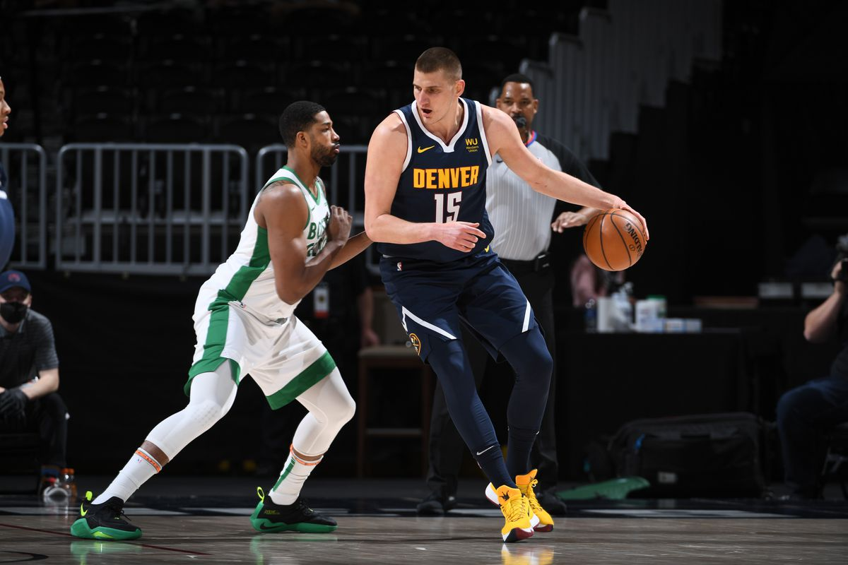 Nikola Jokic of the Denver Nuggets handles the ball during the game against the Boston Celtics on April 11, 2021 at the Ball Arena in Denver, Colorado.