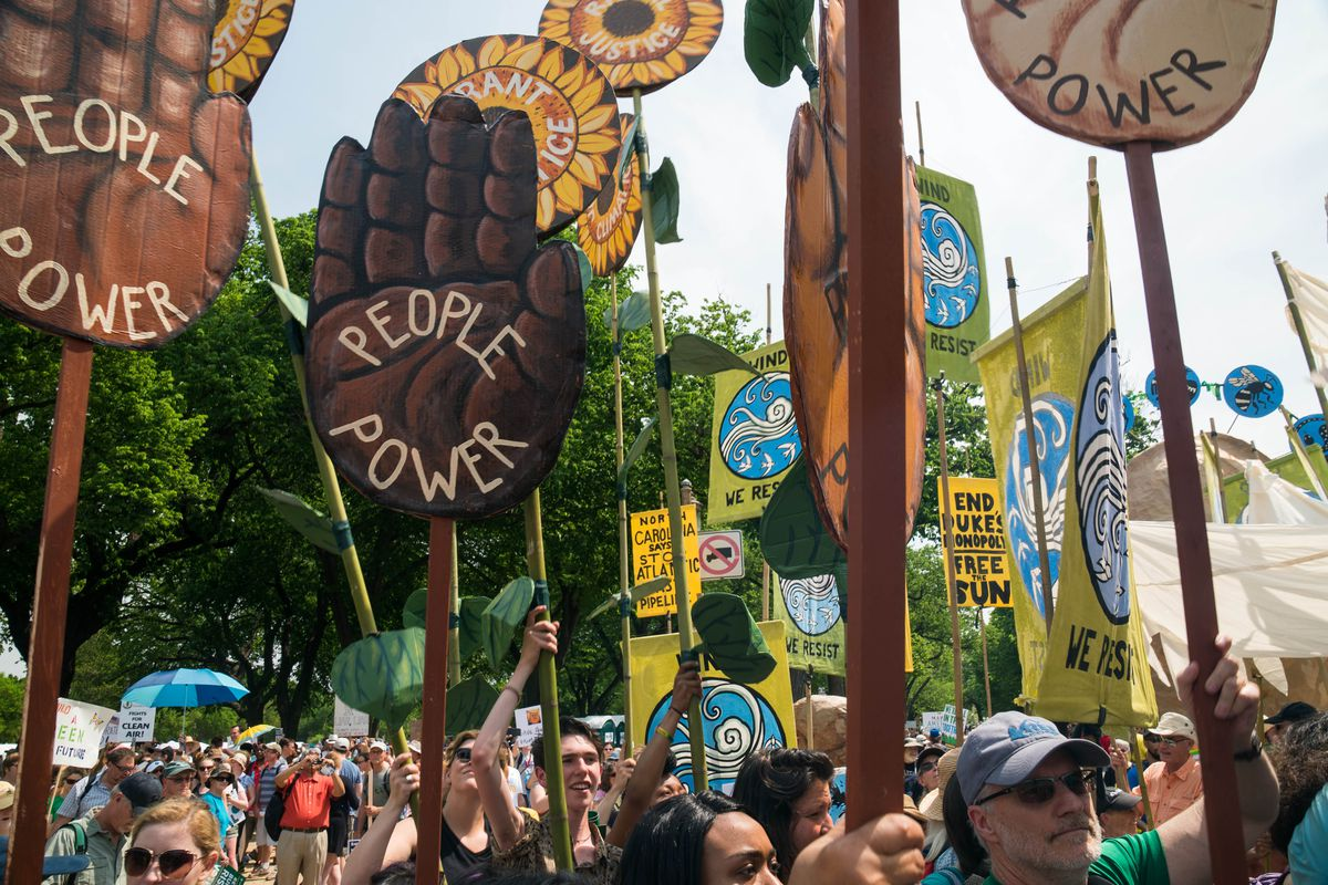 People power written on a large hand sign