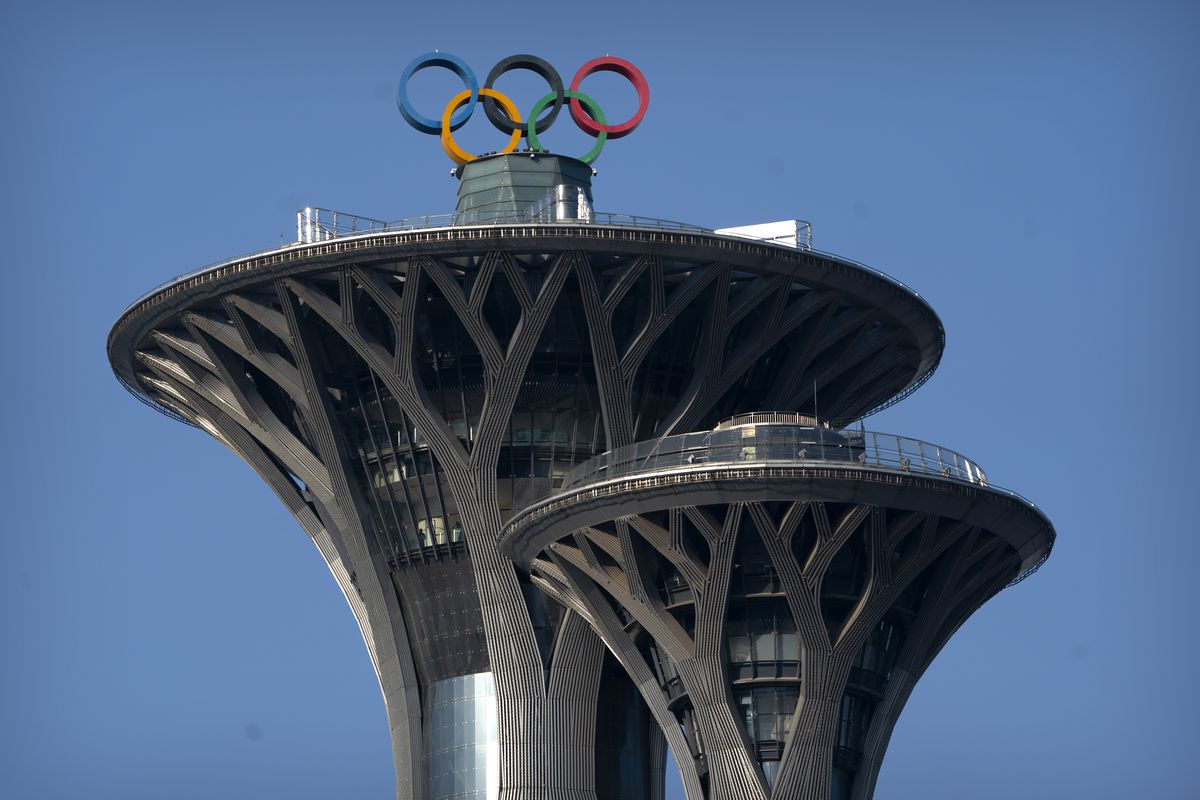 The Olympic rings are visible atop the Olympic Tower in Beijing. Olympic organizers said foreign fans will not be allowed to attend the Winter Games.