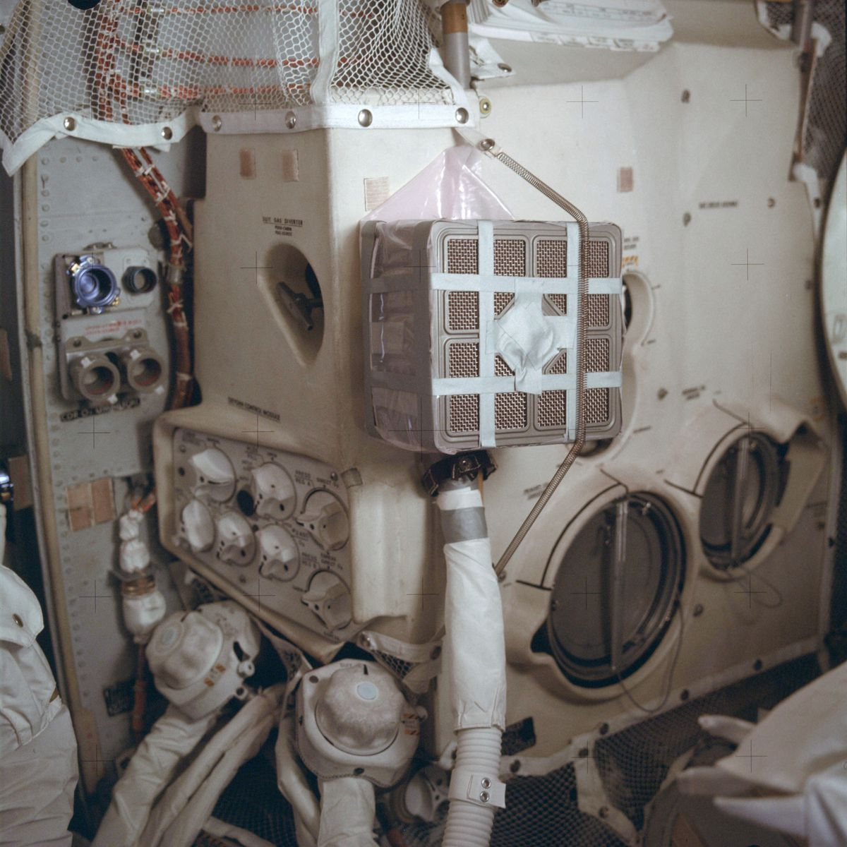 """This April 1970 photo made available by NASA shows the interior of the Apollo 13 lunar module with the """"mail box,"""" an ad hoc device which the crew assembled while in space to remove carbon dioxide from the air. It was designed and tested on the ground in Houston. Because of the explosion of one of the oxygen tanks in the service module, the three men had to use the lunar module as a """"lifeboat"""" on their way back to Earth."""