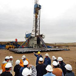 Members of a Shell tour of Pinedale Mesa, Wyo., are shown a drilling rig. The mesa is becoming a flash point in the debate about wildlife vs. energy demands.
