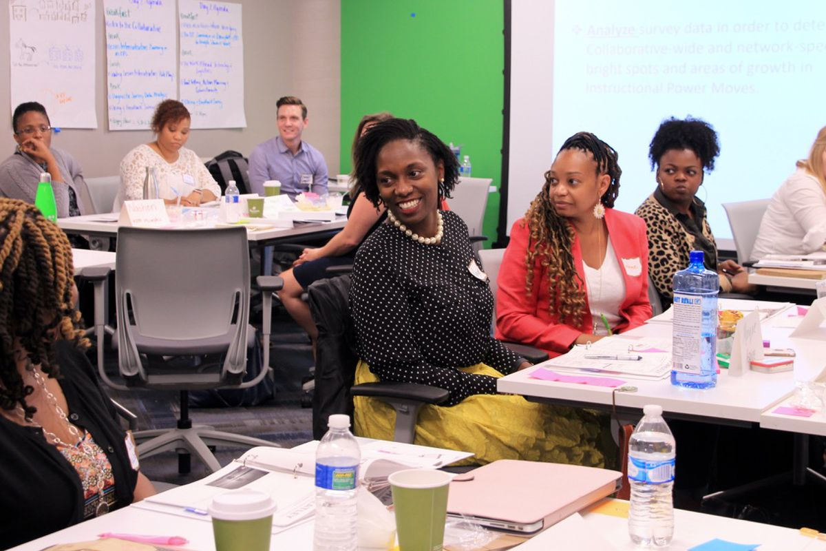 Monique Cincore (center) is one of 23 educators participating in a new collaborative between local charter schools and KIPP.