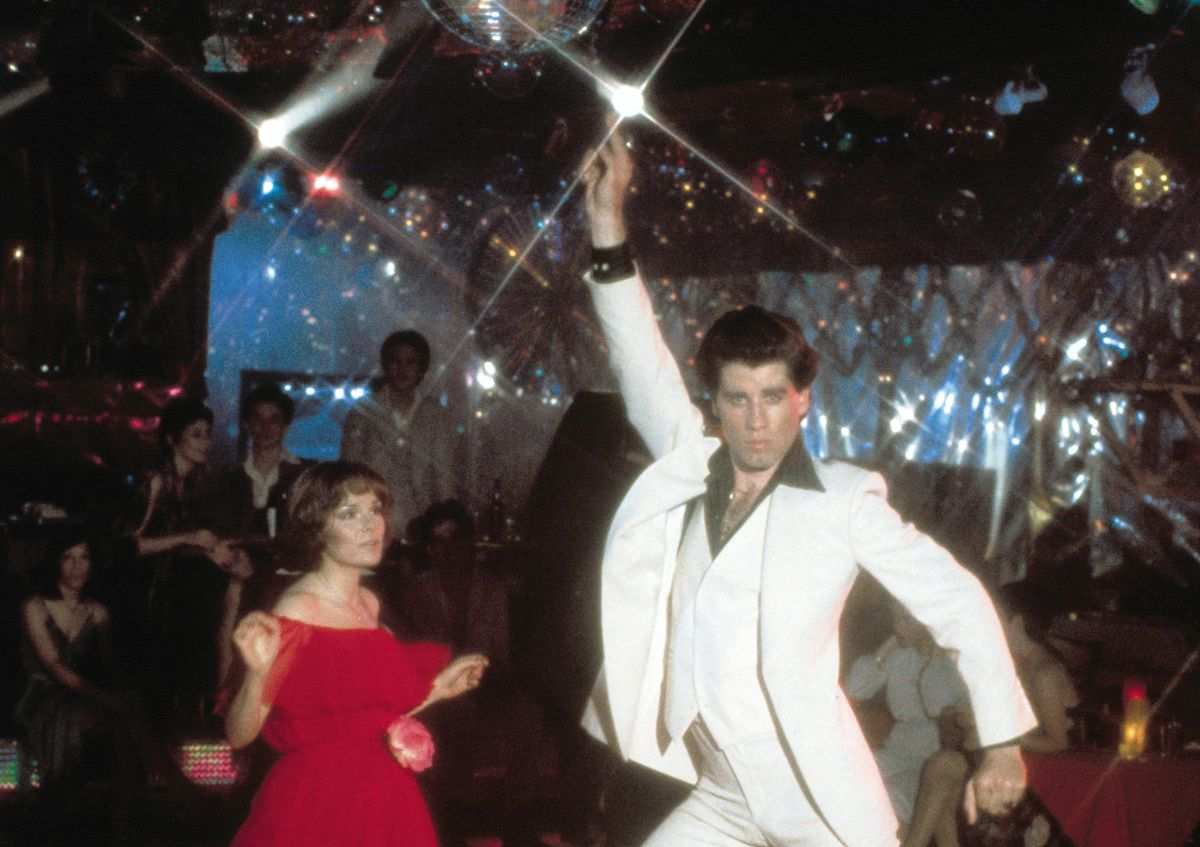 """The white suit that John Travolta wore in """"Saturday Night Fever"""" (alongside Karen Lynn Gorney) belonged for a time to Chicago film critic Gene Siskel. 