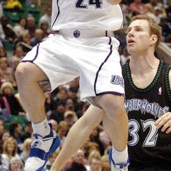 Raul Lopez of the Jazz floats in the lane with Fred Hoiberg of Minnesota at back right during the second half of the Jazz vs MInnesota Timberwolves, NBA basketball game in the Delta Center in Salt Lake City, Utah, February 11, 2005. Photo by Ravell Call (Submission date: 02/11/2005)