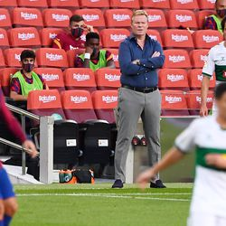 Koeman takes in the action