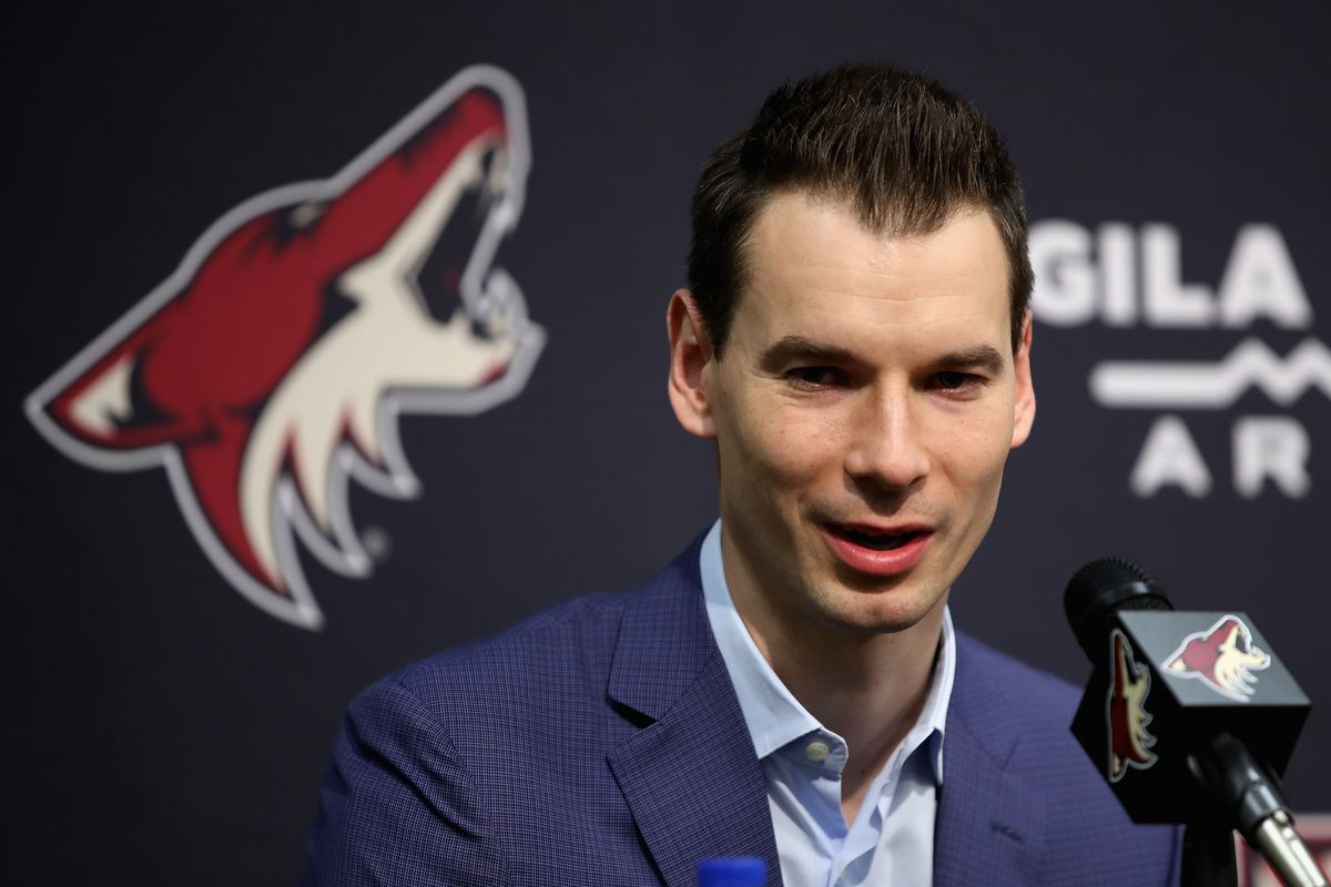 PHOENIX, ARIZONA - DECEMBER 18: General manager John Chayka of the Arizona Coyotes speaks during a press conference to introduce Taylor Hall (not pictured) at Gila River Arena on December 18, 2019 in Glendale, Arizona.