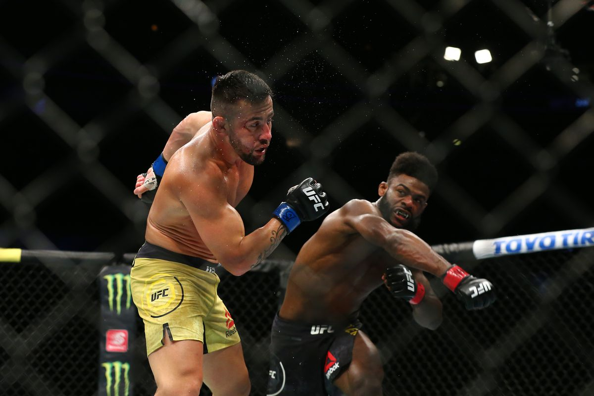 Aljamain Sterling punches Pedro Munhoz at United Center on June 8, 2019 in Chicago, Illinois.