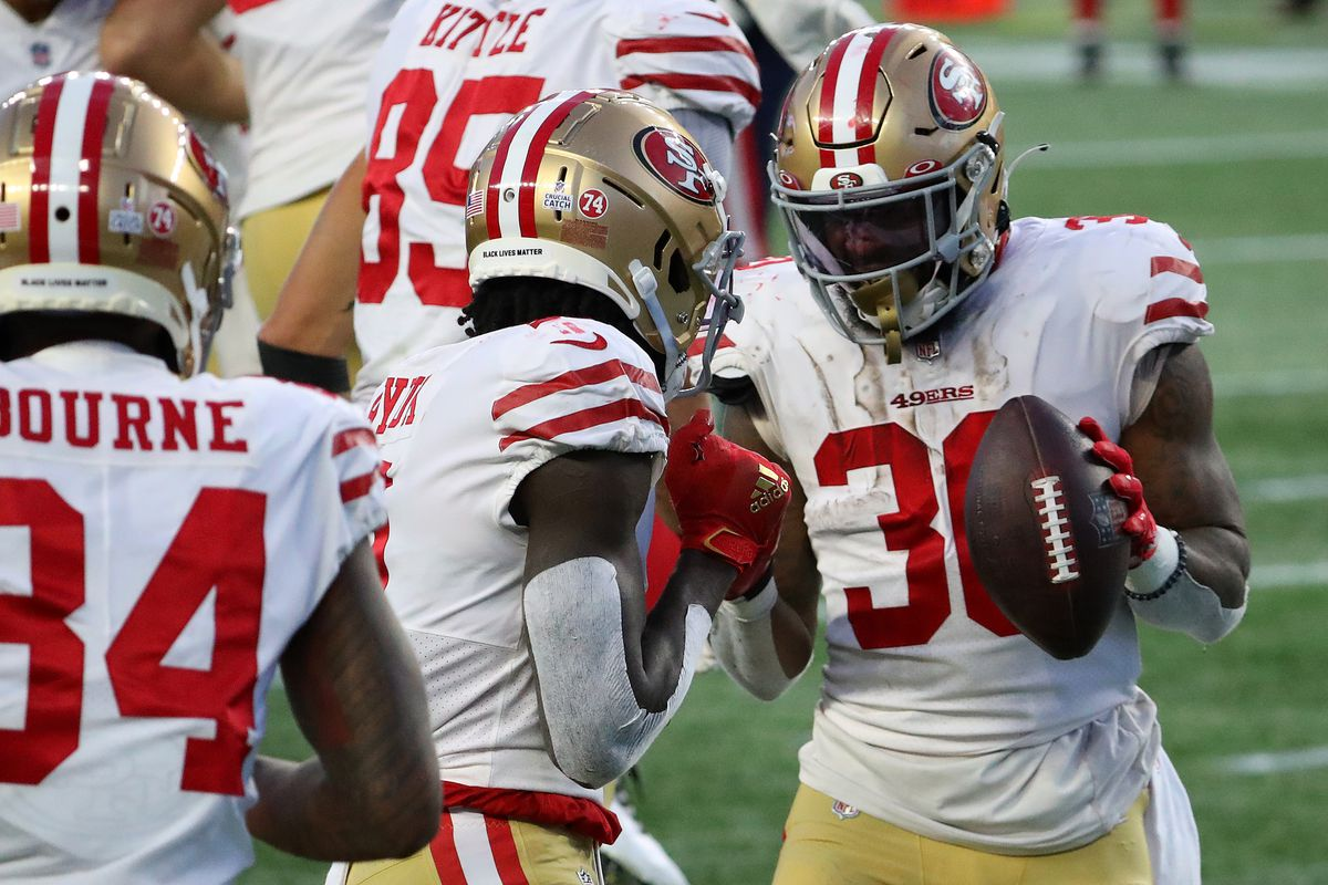 Jeff Wilson Jr. #30 of the San Francisco 49ers celebrates his 16-yard touchdown against the New England Patriots with Brandon Aiyuk #11 during the second quarter of their NFL game at Gillette Stadium on October 25, 2020 in Foxborough, Massachusetts.