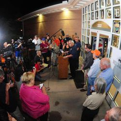 Prescott Ariz. Fire Chief Dan Fraijo, center at podium, gives a news conference in Prescott, Ariz. confirming that 19 members of the City of Prescott's Granite Mountain Hotshot team died while fighting the Yarnell Hill Fire Sunday, June 30, 2013.