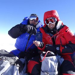 David Roskelley, left, and Steve Pearson hold up a Book of Mormon as they sit on the summit of Mount Everest on the morning of May 19. Both men are members of The Church of Jesus Christ of Latter-day Saints. Roskelley is a member of the Mountainville Third Ward (Alpine Utah Stake), and Pearson has been part of the Longfellow Park Second Ward (Cambridge Mass. Stake) before recently moving to Utah.