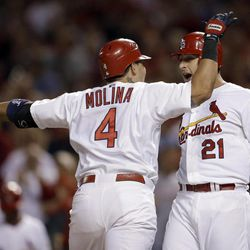 St. Louis Cardinals' Yadier Molina (4) is congratulated by teammate Allen Craig after hitting a two-run home run during the second inning of a baseball game against the Washington Nationals on Friday, Sept. 28, 2012, in St. Louis.