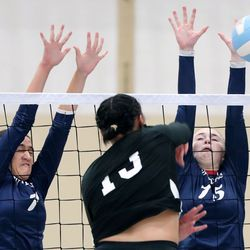 Woods Cross' Anau Tua'one and Danielle Sullivan reach to block West Jordan's Taya Handy's hit during a high school volleyball game at West Jordan High School in West Jordan on Thursday, Sept. 2, 2021.