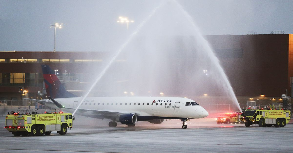 First flight lifts off from America's newest airport in Salt Lake City... image