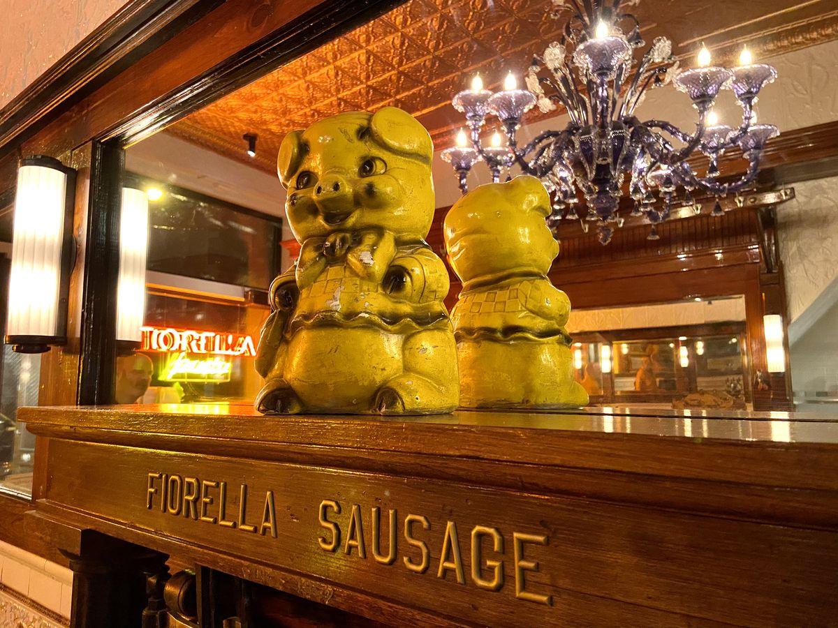 ceramic pig on a mantel that says fiorella sausage