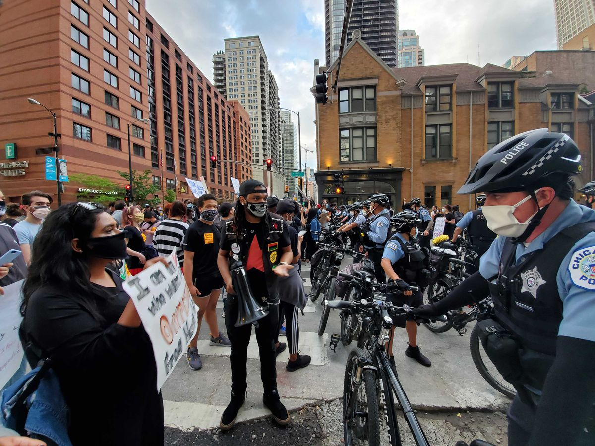 Protesters and Chicago police officers during a march downtown Friday, May 29 over the death in Minneapolis police custody of George Floyd.