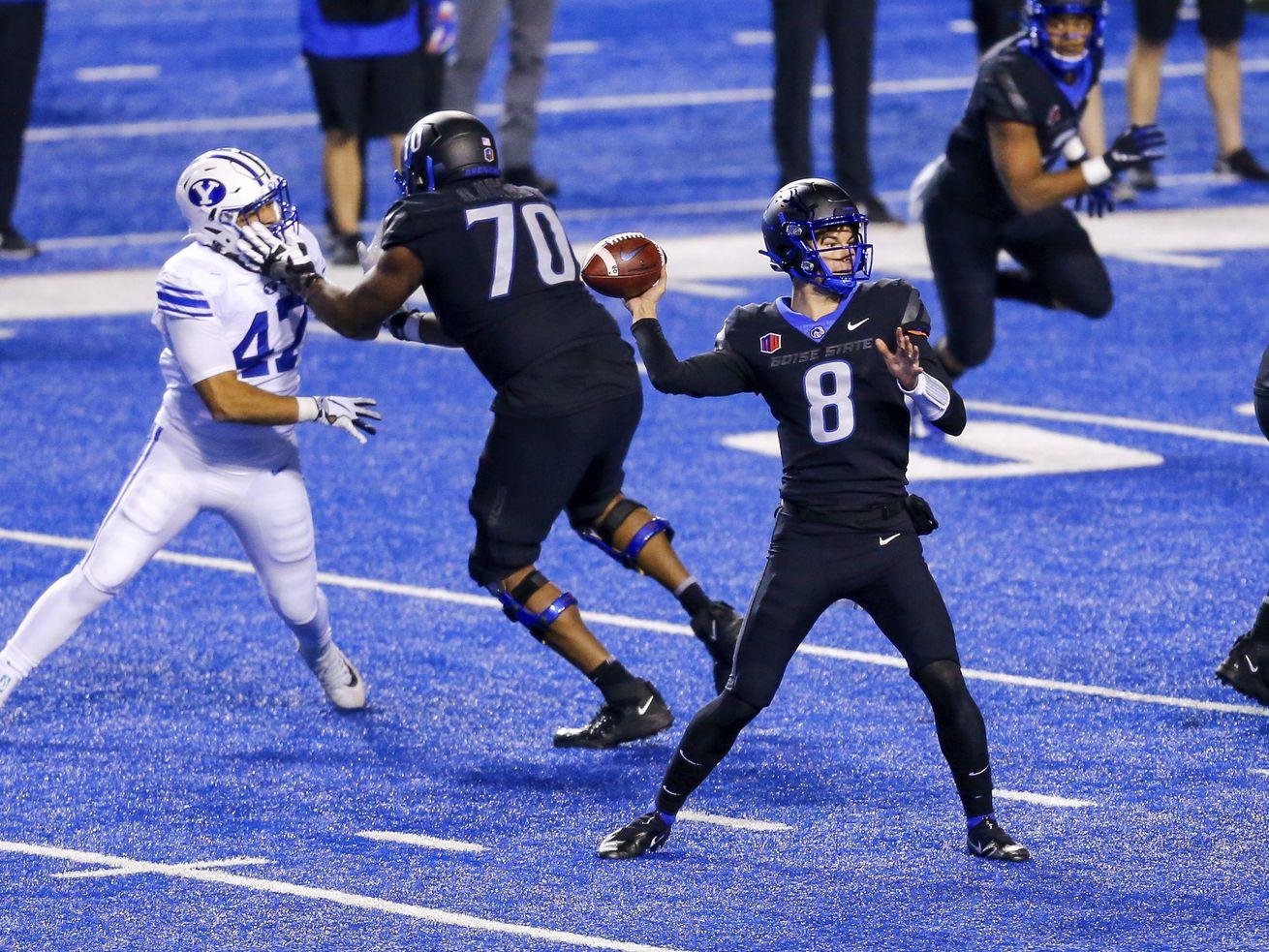 Boise State quarterback Cade Fennegan (8) throws the ball against the BYU defense.