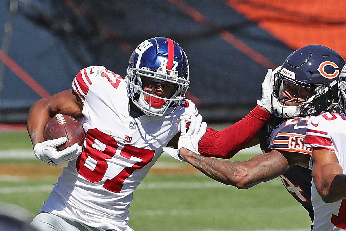 Sterling Shepard of the New York Giants is hit by Buster Skrine of the Chicago Bears at Soldier Field on September 20, 2020 in Chicago, Illinois.