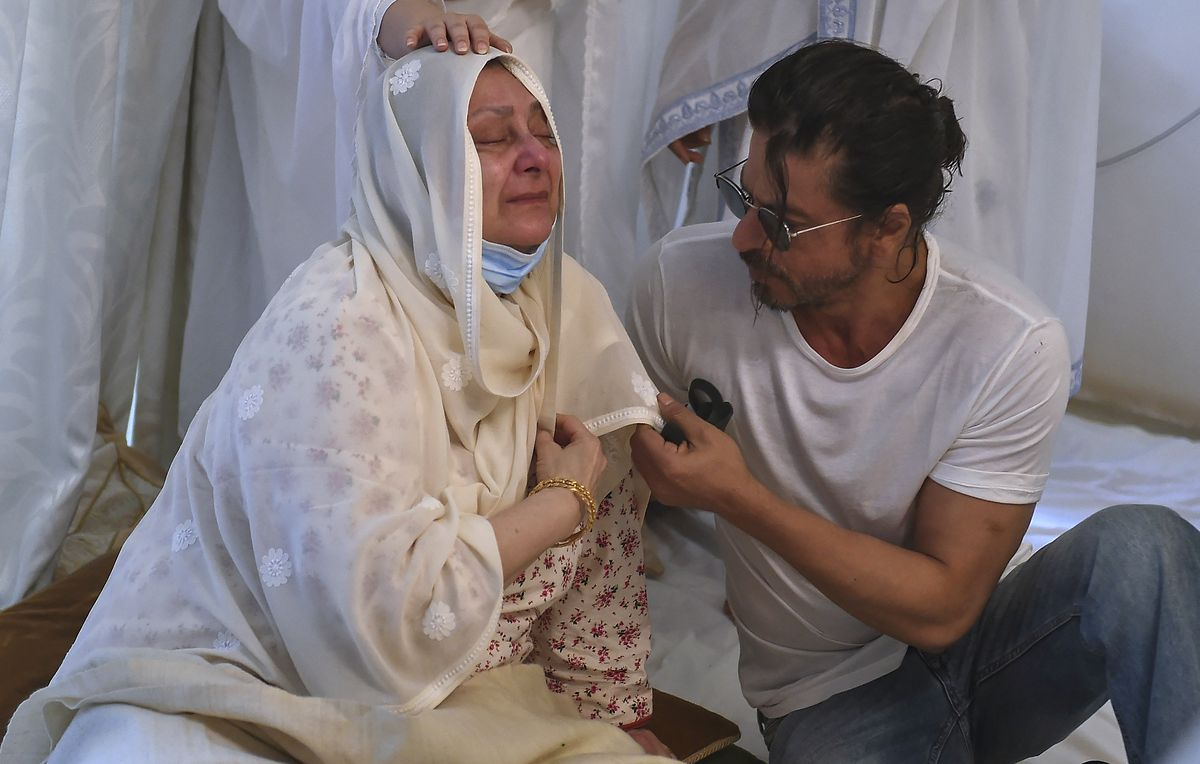 Actor Shahrukh Khan (right) consoles Saira Banu as she mourns death of her husband and Bollywood icon Dilip Kumar at their residence in Mumbai, India, on Wednesday. Kumar, hailed as one of Hindi cinema's greatest actors, died Wednesday in a Mumbai hospital after a prolonged illness. He was 98.