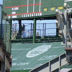 1:52 p.m. St. Louis/Cubs matchup, and new center-field bleacher tarp cover -