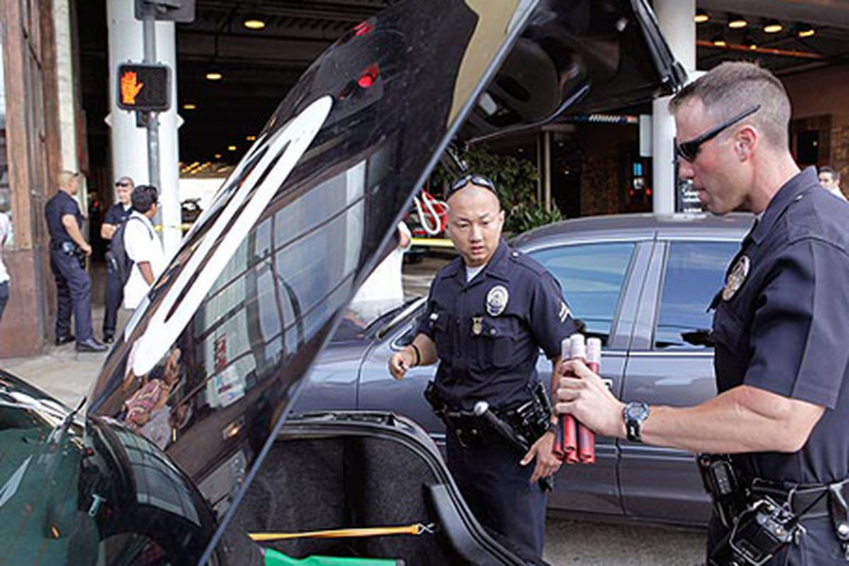 """Police officers investigate the scene.  Image via the <a href=""""mailto:http://www.latimes.com/news/local/la-me-beverly-center-pg,0,1036163.photogallery?index=3"""">LAT</a>"""