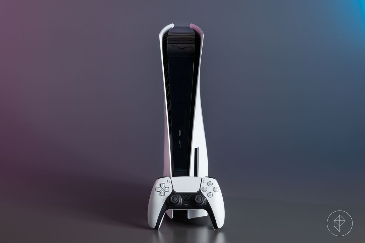 A DualSense controller in front of a PS5 console