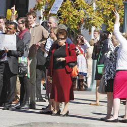 Crowds look for tickets for the afternoon session of the 183rd Semiannual  General Conference of the Church of Jesus Christ of Latter-day Saints Sunday, Oct. 6, 2013, in Salt Lake City.
