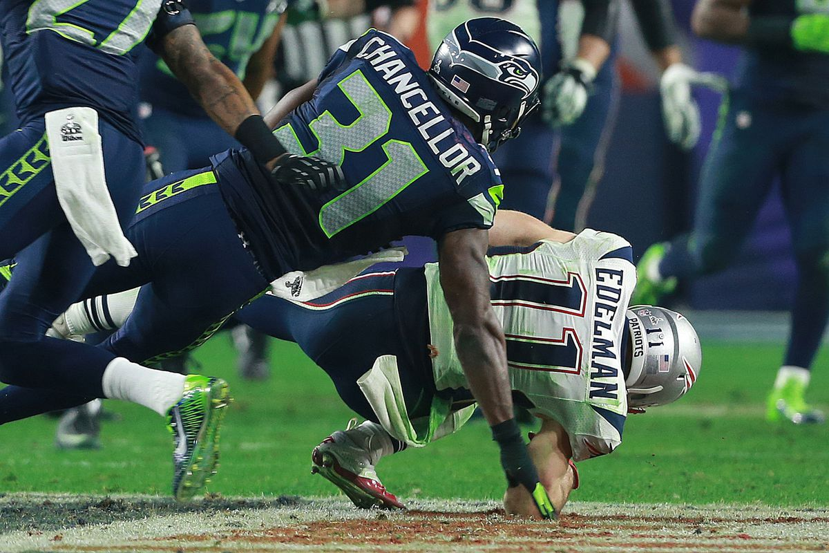 (02/01/2015 Phoenix, AZ) New England Patriots wide receiver Julian Edelman takes a huge hit from Seattle Seahawks strong safety Kam Chancellor in the fourth quarter of Super Bowl XLIX on Sunday, February 1, 2015. Staff Photo by Matt West