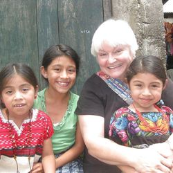 Katie Walther poses with children in Guatemala.
